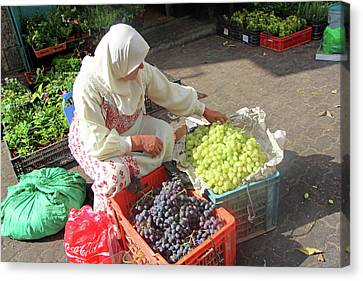 Bethlehem Grapes Seller Canvas Print by Munir Alawi