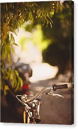 Bicycle In Bozcaada Canvas Print by Ilker Goksen