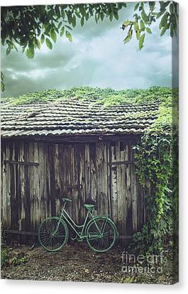 Bicycle In Front Of Barn Canvas Print by Mythja Photography