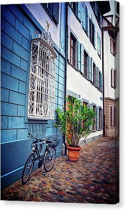 Bicycle On A Cobbled Lane In Basel Switzerland Canvas Print