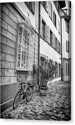 Wrought Iron Bicycle Canvas Print - Bicycle On A Cobbled Street In Basel  by Carol Japp