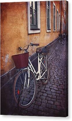 Bicycle With A Basket Canvas Print by Carol Japp