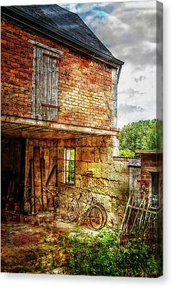 Bicycles In The Courtyard Canvas Print by Debra and Dave Vanderlaan