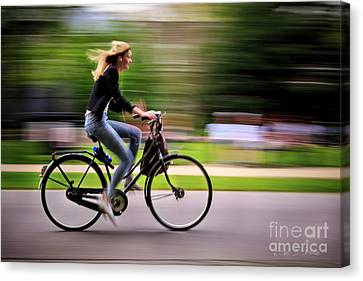 Canvas Print featuring the photograph Bicycling Woman by Craig J Satterlee