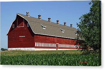 Big Red Barn In Spring Canvas Print by Edward Peterson