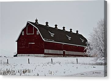 Big Red Barn In The Winter Canvas Print by Edward Peterson