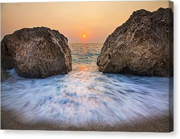 Reflection Canvas Print - Big Rocks And Wave With Sunset On Paradise Island Greece by Sandra Rugina