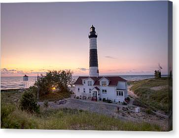 Big Sable Point Lighthouse At Sunset Canvas Print by Adam Romanowicz
