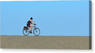 Bike Rider On Levee Canvas Print