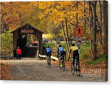 Biking Across The Fallasburg Covered Bridge Canvas Print by Terri Gostola
