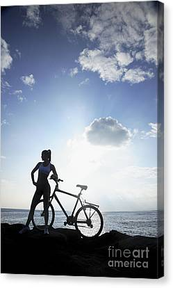 Biking Silhouette Canvas Print by Brandon Tabiolo - Printscapes