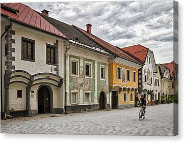 Canvas Print featuring the photograph Biking Through Radovljica - Slovenia by Stuart Litoff