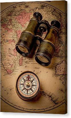Binoculars And Compass On Map Canvas Print by Garry Gay
