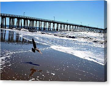 Bird Flies Towards Pier Canvas Print