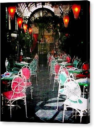 Bistro Chairs Canvas Print by Lori Seaman