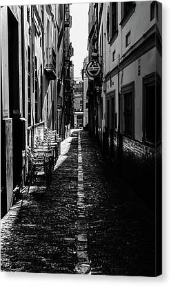 Black And White In Seville Canvas Print by Andrea Mazzocchetti