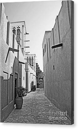 Black And Whitetraditional Middle Eastern Street In Dubai Canvas Print by Chris Smith