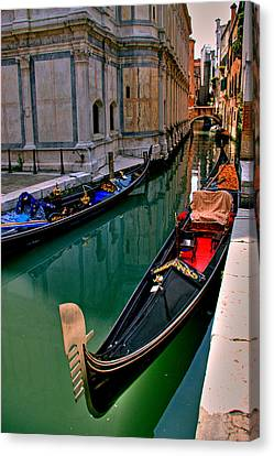 Black Gondola Canvas Print by Peter Tellone