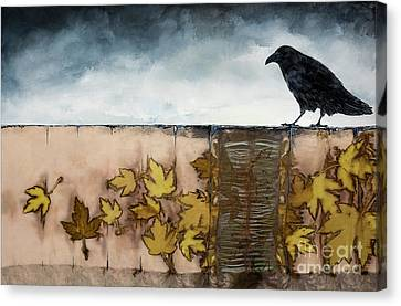 Black Raven Sits Above Scattered Leaves Canvas Print by Carolyn Doe