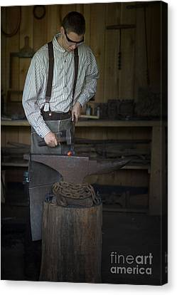 Canvas Print featuring the photograph Blacksmith At Work by Liane Wright