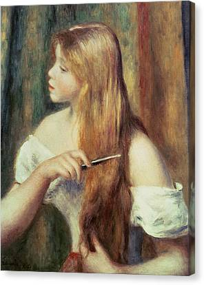 Blonde Girl Combing Her Hair Canvas Print by Pierre Auguste Renoir