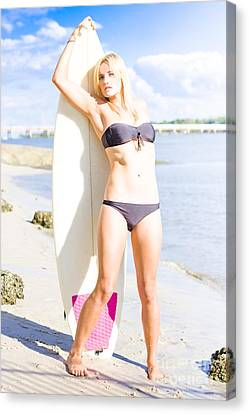 Blonde Surfboarder With Surfboard At Beach Canvas Print