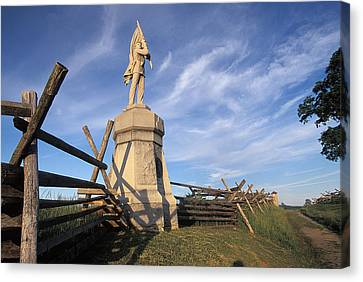Bloody Road With A Statue Canvas Print by Richard Nowitz