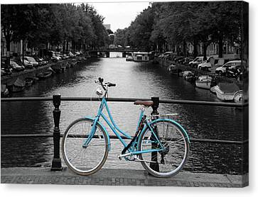 Blue Bicycle By The Canal Canvas Print by Aidan Moran