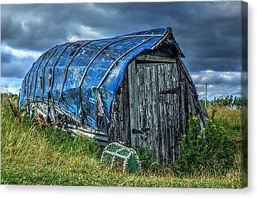 Blue Boat Hut Canvas Print by Chris Whittle