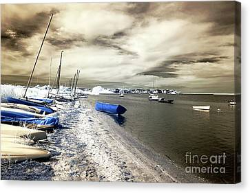 Blue Boat In The Water Canvas Print by John Rizzuto