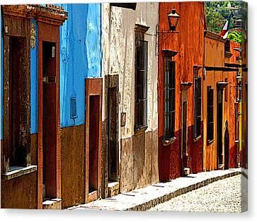 Blue Casa Row Canvas Print by Mexicolors Art Photography