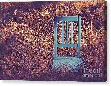 Blue Chair Out In A Field Of Talll Grass Canvas Print by Edward Fielding