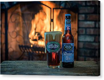 Blue Point Winter Ale By The Fire Canvas Print by Rick Berk