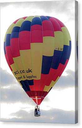 Canvas Print featuring the photograph Blue, Red And Yellow Hot Air Balloon by Scott Lyons