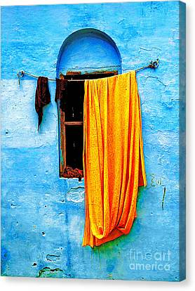 Blue Wall With Orange Sari Canvas Print by Derek Selander