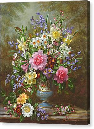 Bluebells Daffodils Primroses And Peonies In A Blue Vase Canvas Print by Albert Williams