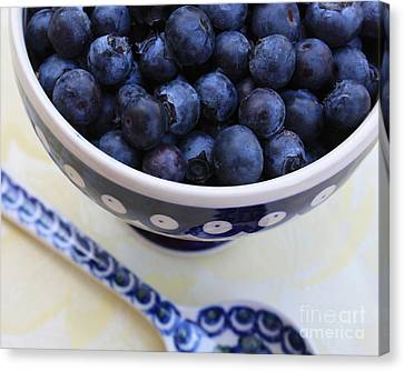 Blueberries With Spoon Canvas Print by Carol Groenen