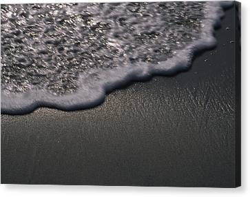Blurred Motion Of A Wave On The Shore Canvas Print by Stacy Gold