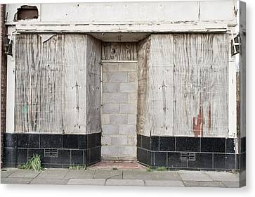Boarded Up Shop Canvas Print by Tom Gowanlock