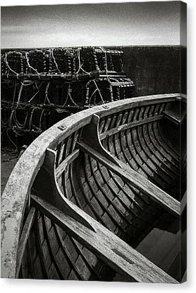 Boat And Creel Nets Canvas Print by Dave Bowman
