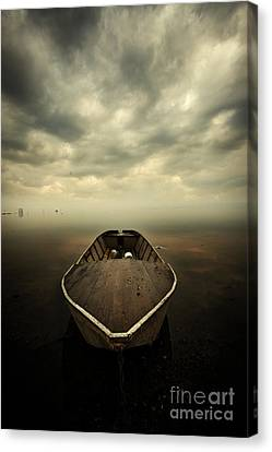 Boat And Storm Canvas Print by Caio Caldas