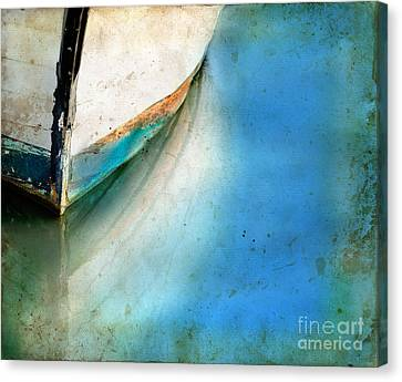 Bow Of An Old Boat Reflecting In Water Canvas Print by Jill Battaglia
