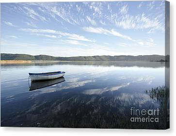Boat On Knysna Lagoon Canvas Print by Neil Overy