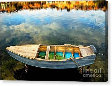 Boat On Lake Canvas Print by Silvia Ganora