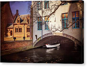 Boat Under A Little Bridge In Bruges  Canvas Print