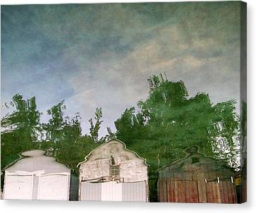 Boathouses With Sky And Trees Canvas Print by Michelle Calkins