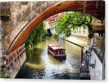 Boating On The Canal In Prague Canvas Print by George Oze