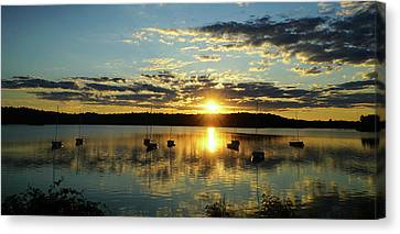 Boats At Sunset Panoramic Canvas Print by Lilia D