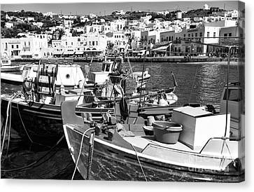 Boats In The Mykonos Harbor Mon Canvas Print by John Rizzuto