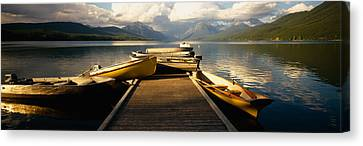 Boats Moored At A Dock, Mcdonald Lake Canvas Print by Panoramic Images